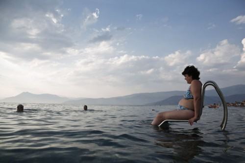 """Kastrioti, who suffers from multiple sclerosis, enters the sea with a """"Seatrac"""" at a beach in Alepochori"""
